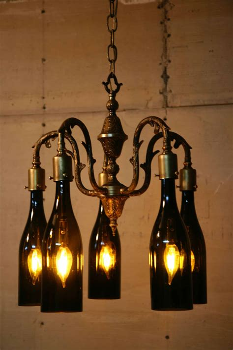 wine bottle chandelier recycled antique chandelier using wine bottles as globes