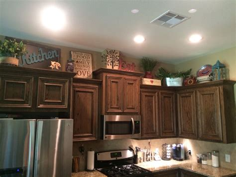 decorating ideas for kitchen cabinet tops above kitchen cabinets decor awesome