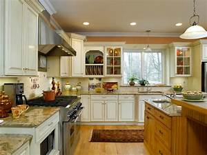Off-White Kitchen Cabinets with Contrasting Island