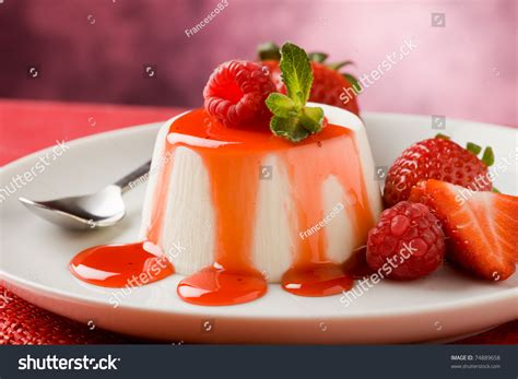 photo of italian panna cotta dessert with strawberry sirup and mint leaf 74889658