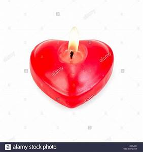 One red candle burning in heart shape isolated on white ...