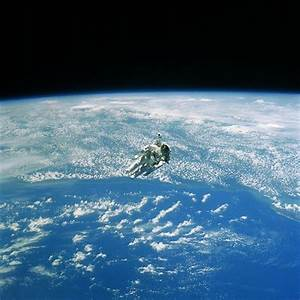 NASA astronaut floats above Earth in a space suit [Amazing ...