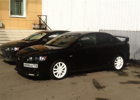 white mitsubishi lancer with black rims white rims black lancer x бортжурнал mitsubishi lancer