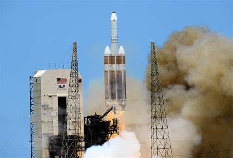 Delta Heavy rocket launches from Cape Canaveral carrying ...