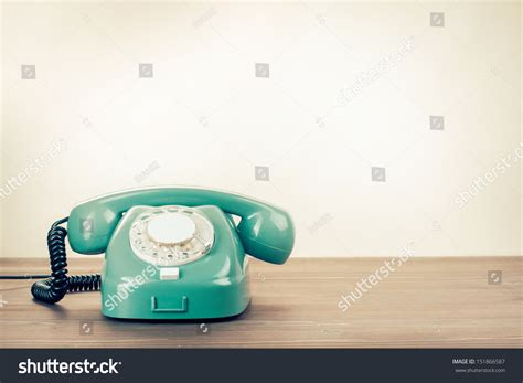 proactive phone number retro rotary telephone on wood table stock photo 151866587