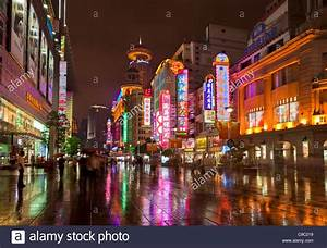 Night time on Nanjing Road east, Shanghai city centre ...