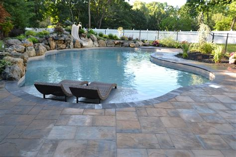 ideas for swimming pool surrounds in ground pool with spillover spa there s more than one way to make a splash