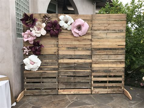 pallet wall with paper flowers perfect for bridal shower