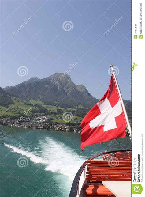 Hergiswil To Lucerne By Boat by Mount Pilatus With Swiss Flag And Of Boat Stock
