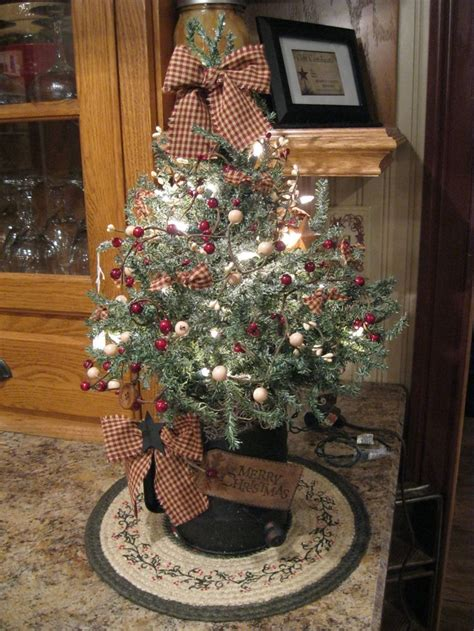 pictures of primitive christmas trees 774 best trees images on primitive deco and