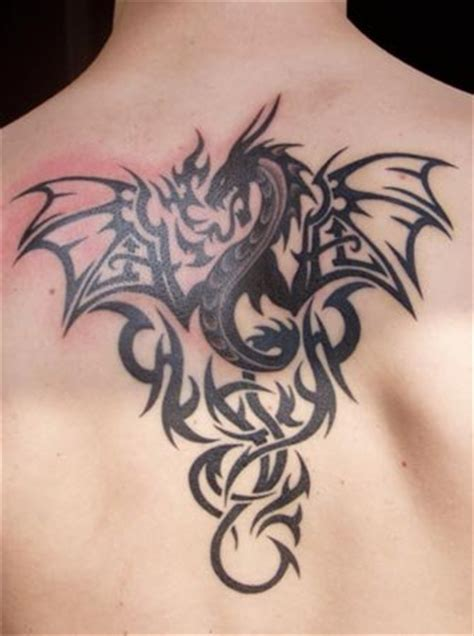 Cool Back Tattoo Of Black Dragon With Different Patterns