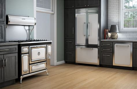 green kitchen cabinets with white appliances airy green walls and white appliances soften the bold