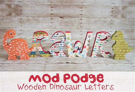 mod podge pictures on wood letters mod podge wooden dinosaur letters 12886