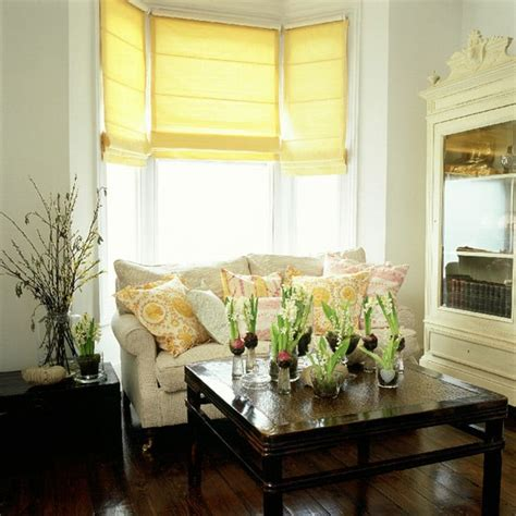 Living Room Artificial Flowers by A Neutral Living Room With Yellow Blinds And