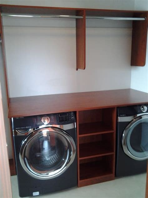 Master Closet With Washer And Dryer washer and dryer in a master closet with space to hang and