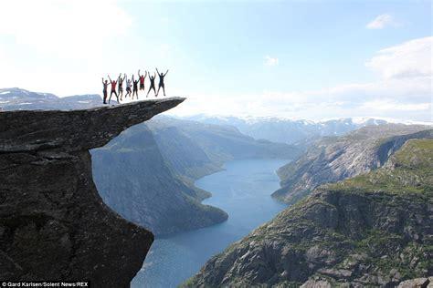 Thrill Seekers Jump On Trolltunga Clifftop 2300ft Above