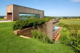 hillside home plans contemporary hillside home in brazil disappears into the landscape modern house designs