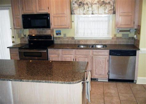 brown cabinets with white countertops desert brown granite with white cabinets roselawnlutheran