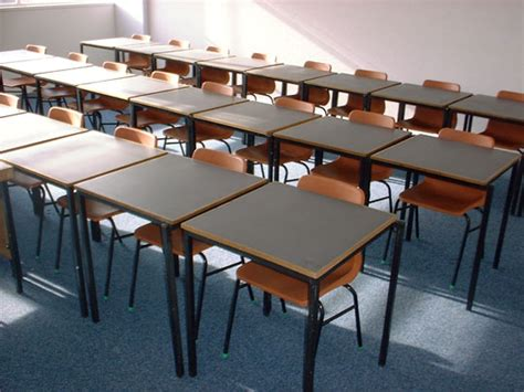 three rows of student desks and chairs