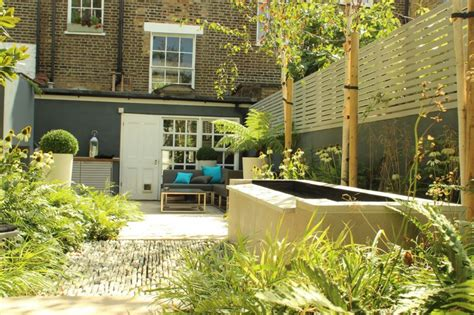 townhouse backyard backyard landscaping ideas dense greenery complemented by a rock texture the barnsbury townhouse