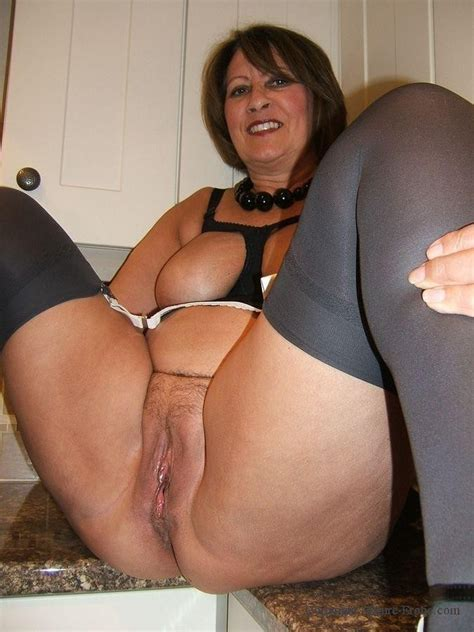 Gilf Posing In The Kitchen Big Tits Porn Pic