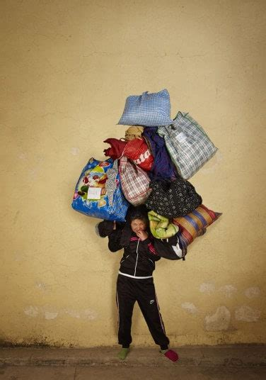 photographer documents people carrying heavy loads