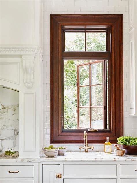 Kitchen Sink with Gold Faucet Under Window   Transitional