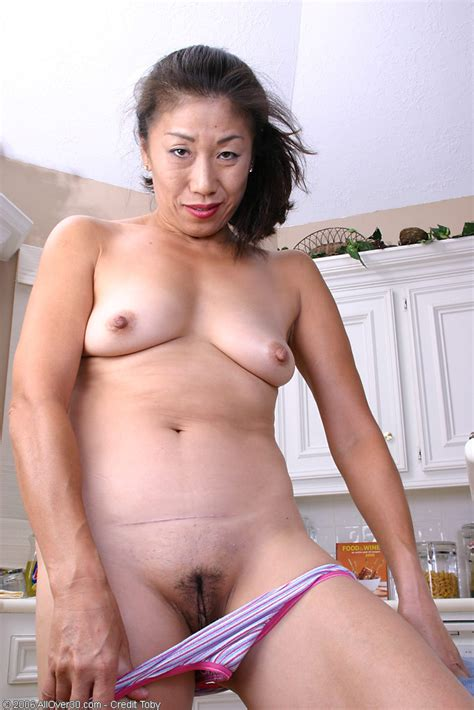 Mature Asian Woman Home From Tennis Practice And Feeling Horny Pichunter
