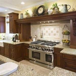 Above kitchen cabinet decor ideas kitchen design ideas for Above kitchen cabinet decorations
