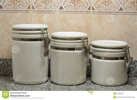 white kitchen storage jars three white ceramic jars on kitchen counter stock photo 1407