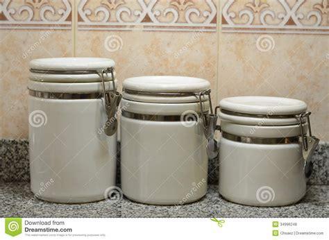 Three White Ceramic Jars On Kitchen Counter Stock Photo