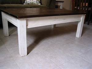 Distressed coffee table bring to the interior of a piece for Distressed white round coffee table