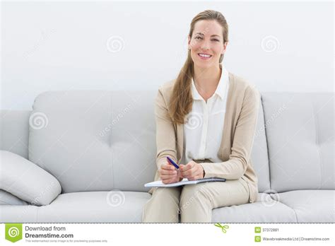 One Person Sofa by Smiling Female Psychologist Sitting On Sofa Stock Image