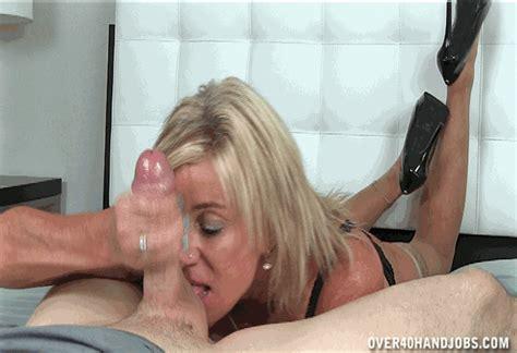 Sexy Voluptuous Milf Giving Handjob