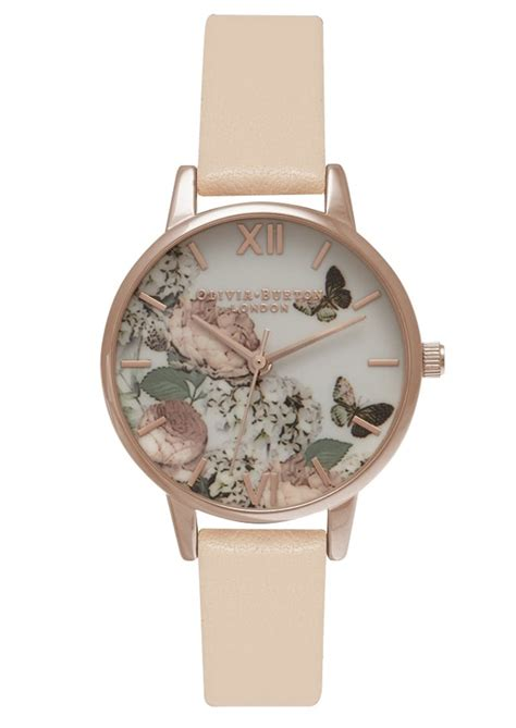 Olivia Burton Enchanted Garden Watch  Nude Peach & Rose Gold. Bezel Set Diamond Eternity Band. Sterling Silver. Cloth Bracelet. Rose Gold Diamond