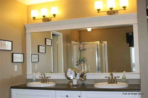 This full wall mirror starts at the level of the vanity and continues all the way up to the ceiling of this stone tile clad bathroom. Large Framed Bathroom Mirrors - Decor IdeasDecor Ideas