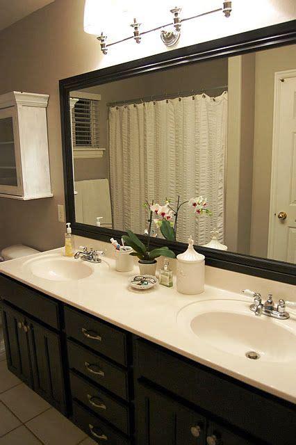 love  dark wooden cabinets    mirror