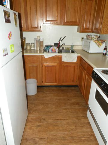pictures of floor tiles for kitchens new plank flooring in kitchen bath and living areas 9101