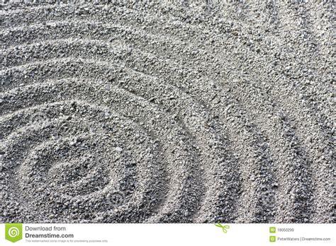 zen garden circular raked gravel pattern detail royalty