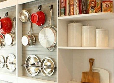remodelaholic diy wall mounted pot rack   shallow