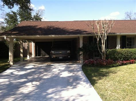 Add Garage Door To Carport by Building An Enclosed Garage From A Carport