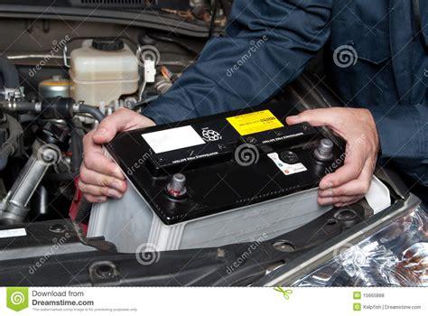 auto mechanic replacing car battery stock photo image
