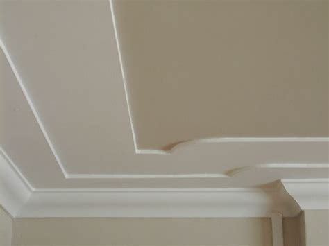 Cutting And Applying Plaster-based Cornice To Beautify