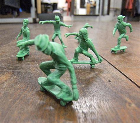 toy boarders  green army men  skateboard