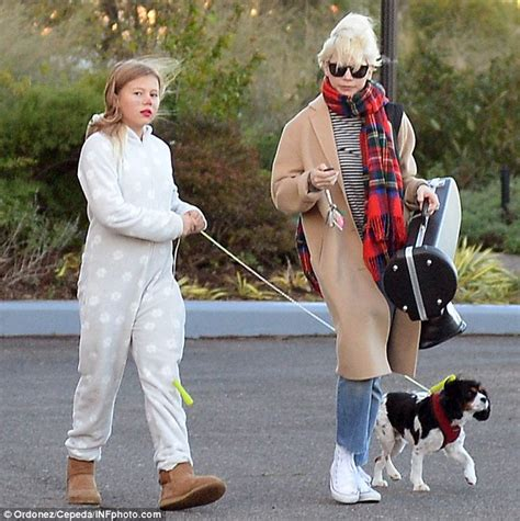 light blue cut up jeans michelle williams 39 daughter matilda ledger dons onesie and