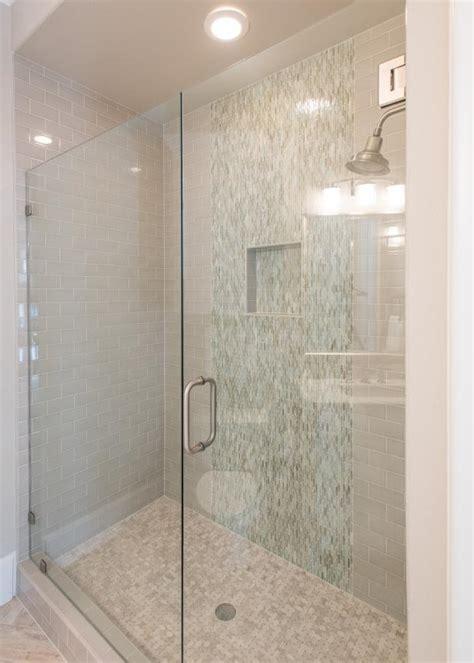 neutral subway tile shower  frameless glass door hgtv