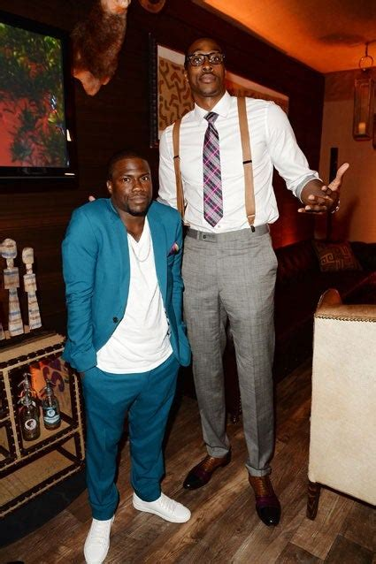 kevin hart standing   tall people    day