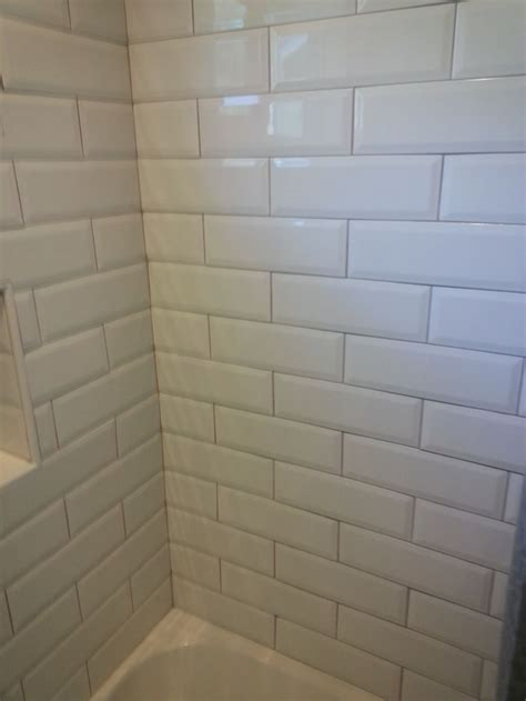 white beveled subway tile  tan grout ignore  tub