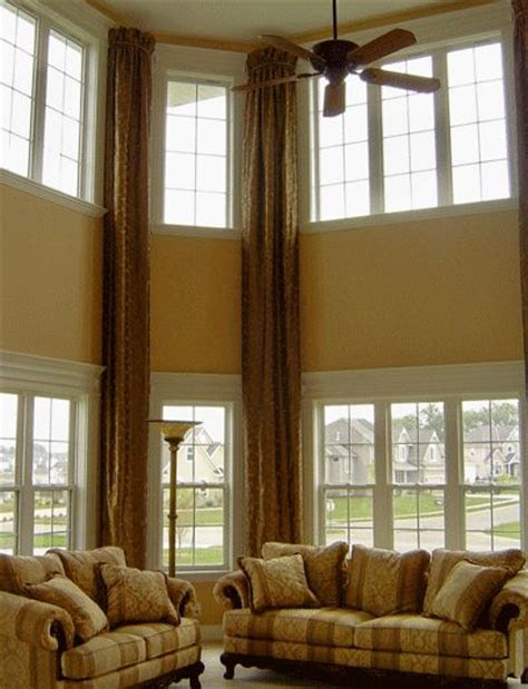 drapes accent the high ceiling family room