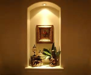 curved top wall niche with light wall niches
